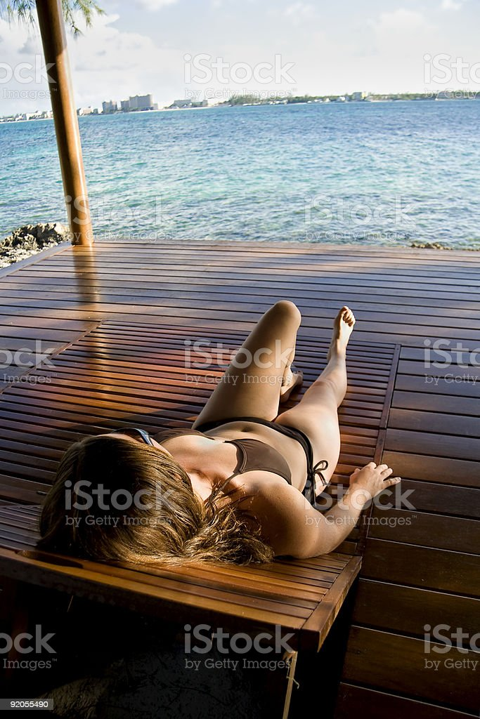 Young Caucasian Woman relaxing in the tropics royalty-free stock photo