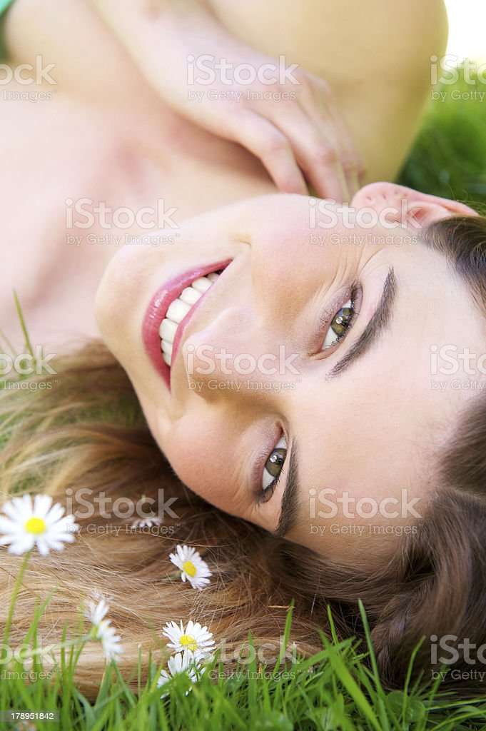 Young caucasian woman smiling outdoors with flowers royalty-free stock photo