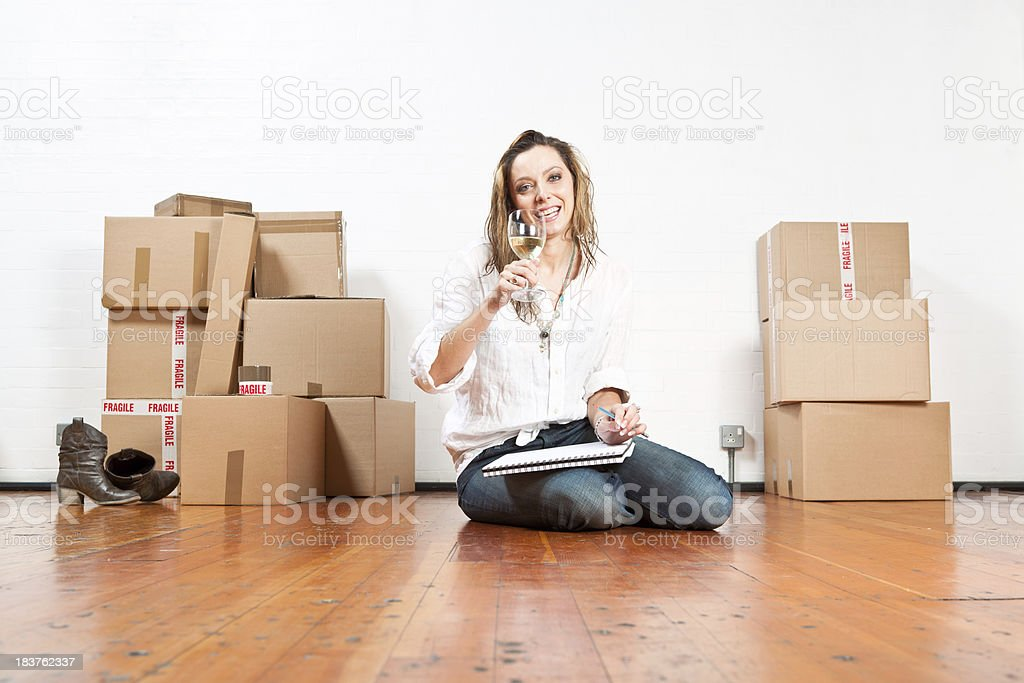 Young caucasian woman toasting the new house royalty-free stock photo