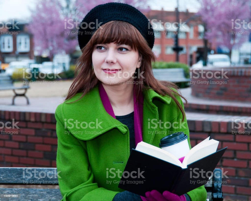 Young caucasion women reading outside stock photo