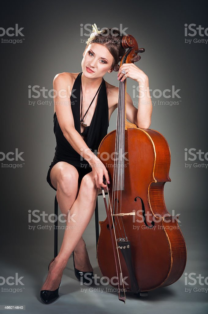 young cellist stock photo