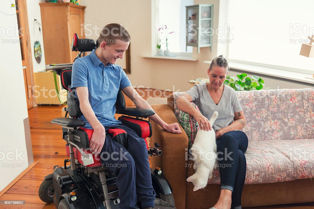 Young Cerebral Palsy patient at home stock photo