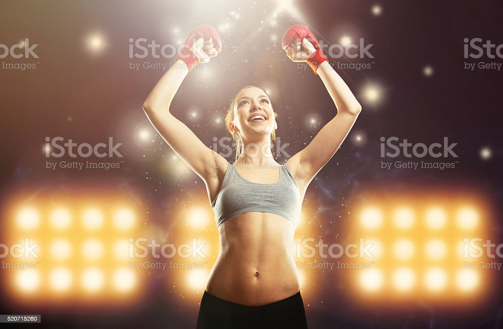 Young champion woman boxer celebrating victory stock photo
