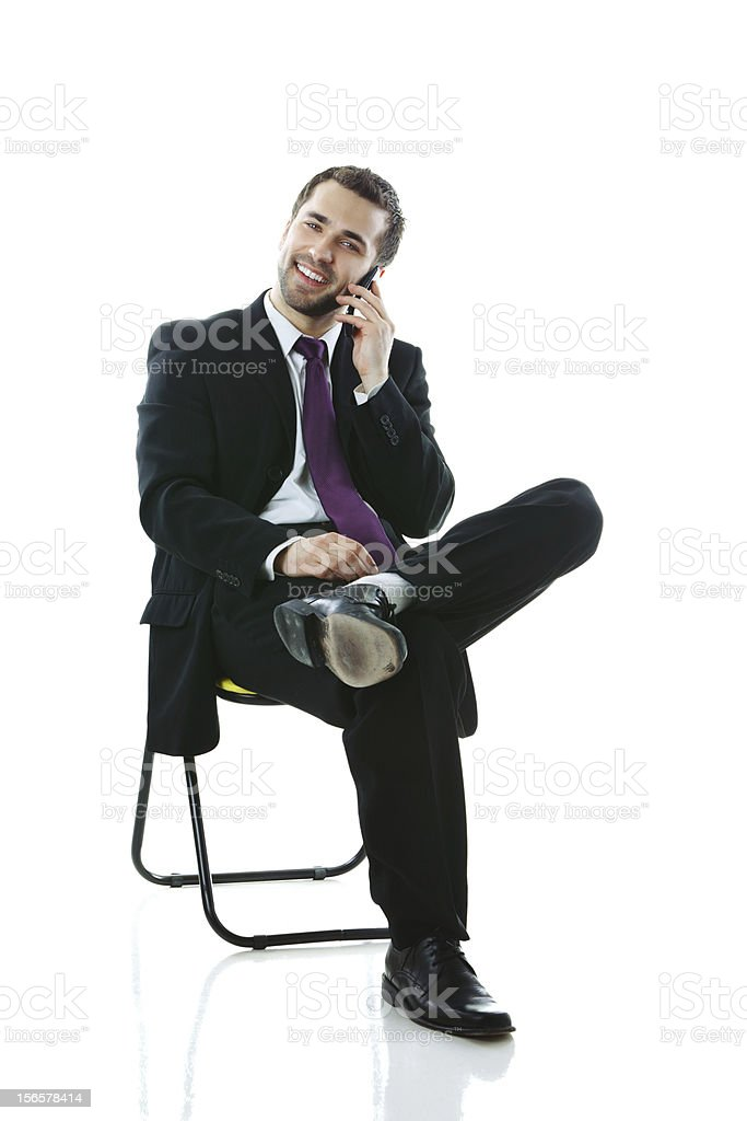 Young cheerful businessman on the phone royalty-free stock photo
