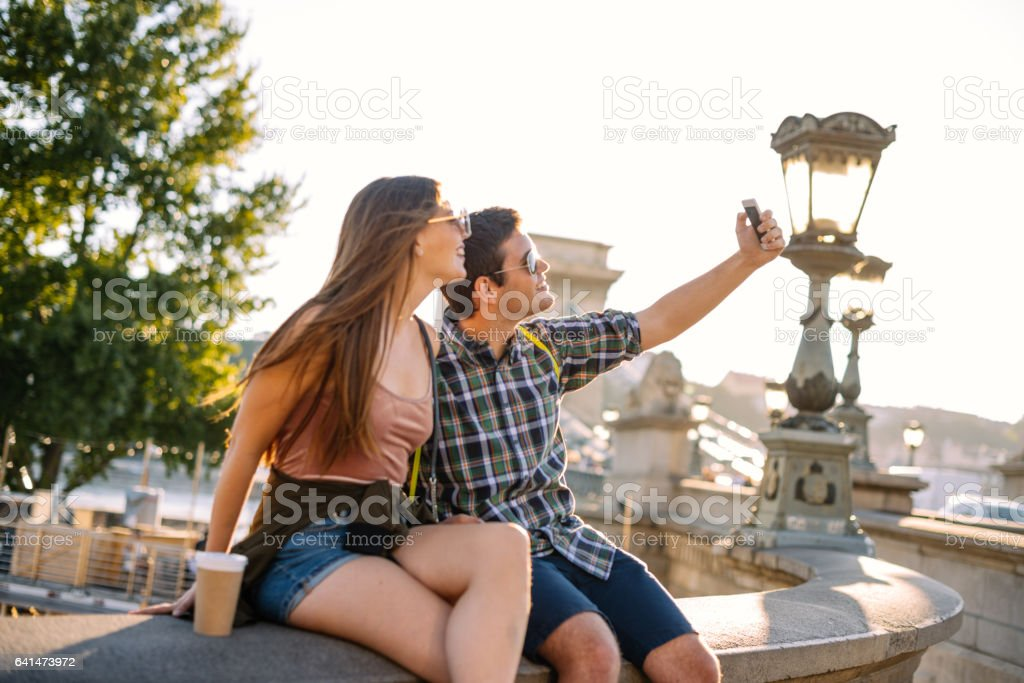 Young cheerful couple taking selfie in Budapest, Hungary stock photo