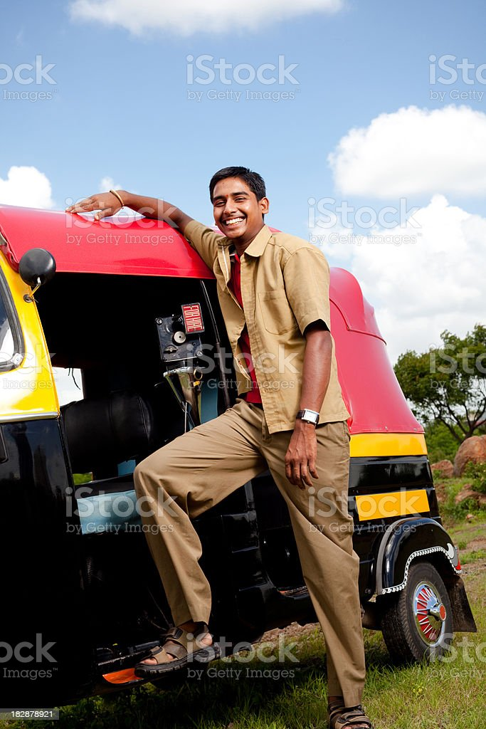 Young Cheerful Indian Auto Rickshaw Driver royalty-free stock photo