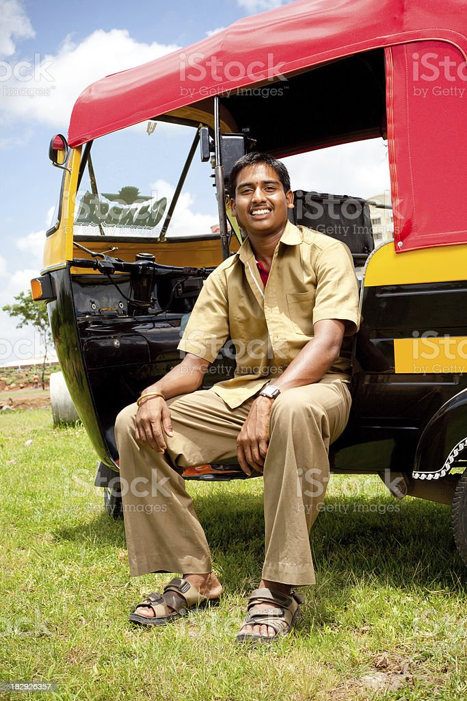 Young Cheerful Indian Auto Rickshaw Driver stock photo