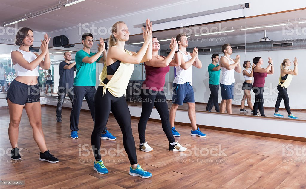 Young cheerful people dancing zumba elements stock photo