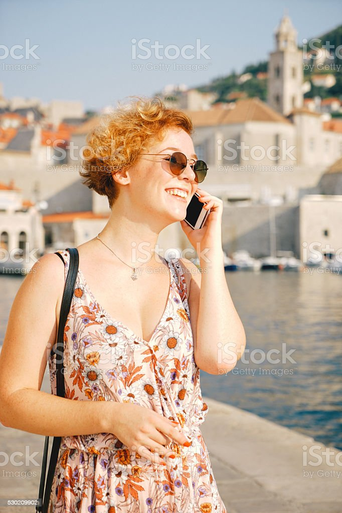 Young Cheerful Woman On The Phone stock photo