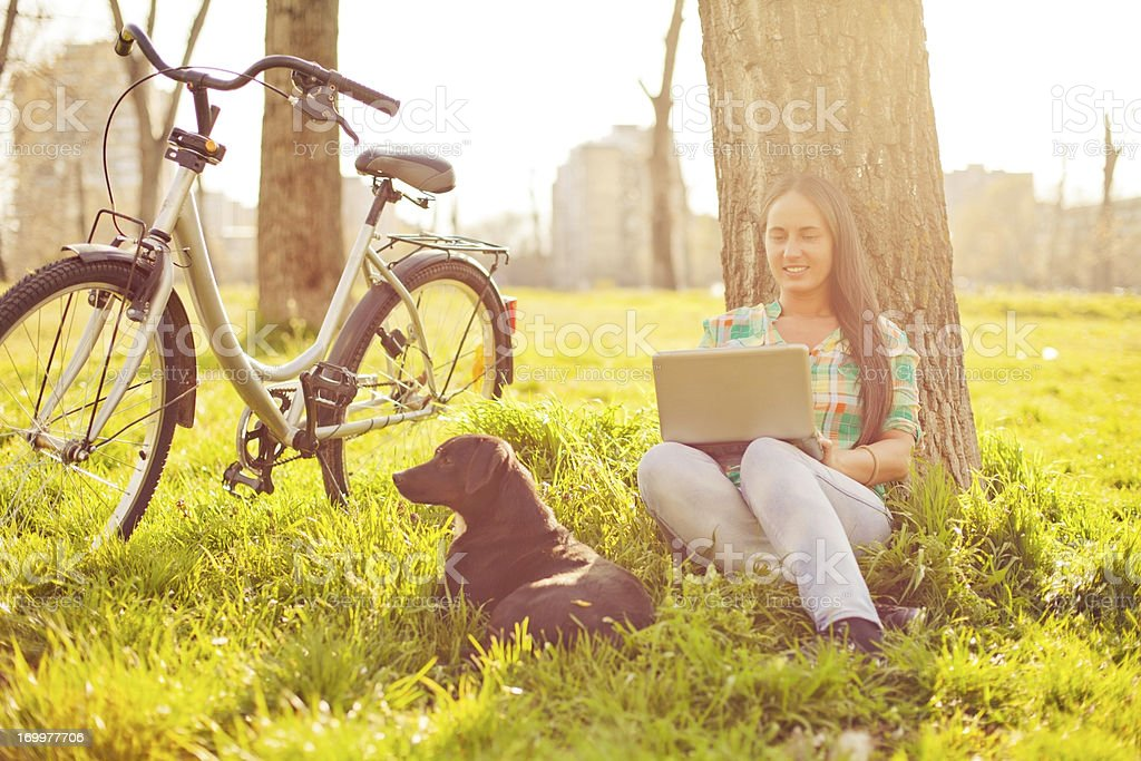 Young cheerful woman resting in the park. royalty-free stock photo