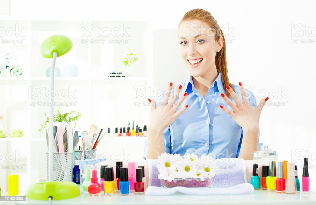 Young Cheerful Woman showing her new nails. royalty-free stock photo