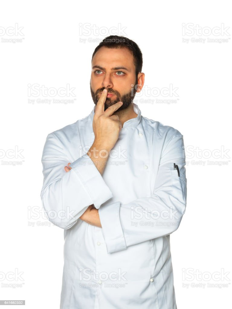 Young chef on white background. stock photo