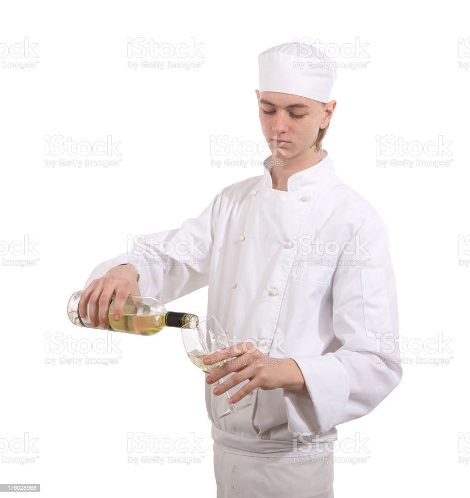 Young Chef pouring white wine royalty-free stock photo