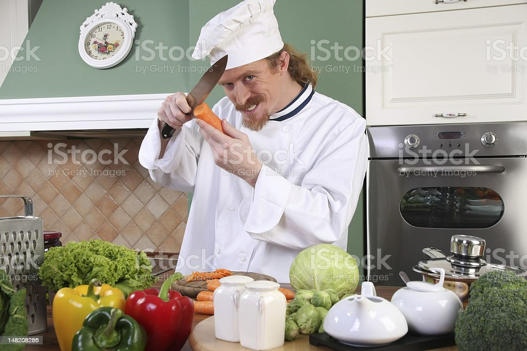 Young chef preparing lunch in kitchen royalty-free stock photo