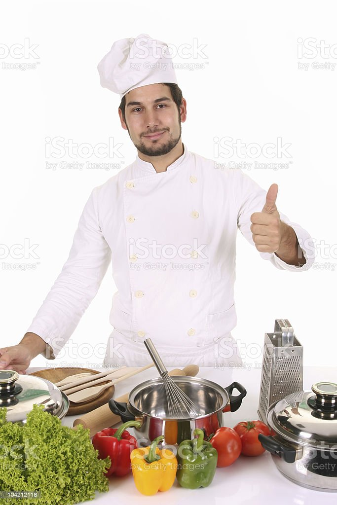 young chef preparing lunch royalty-free stock photo