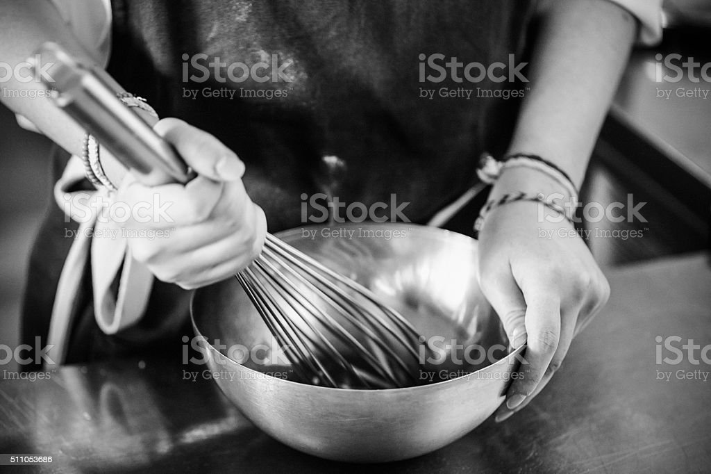Young chef working on kitchen stock photo