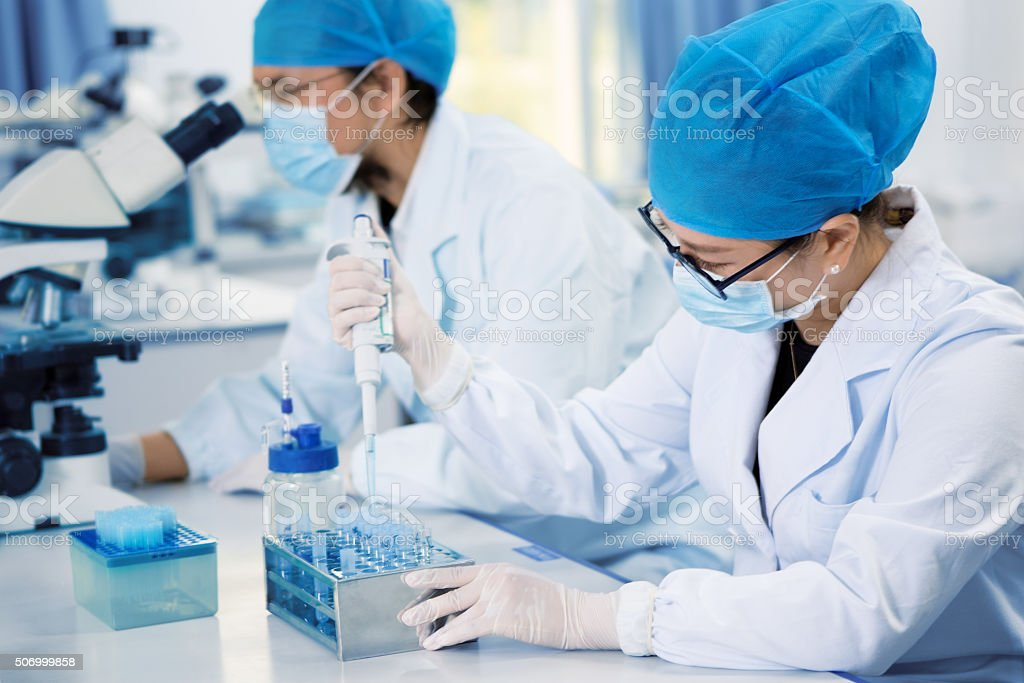 Young chemist in the laboratory stock photo