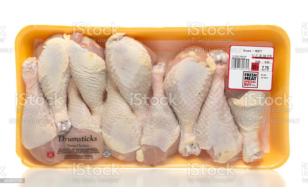 Young chicken drumsticks package stock photo