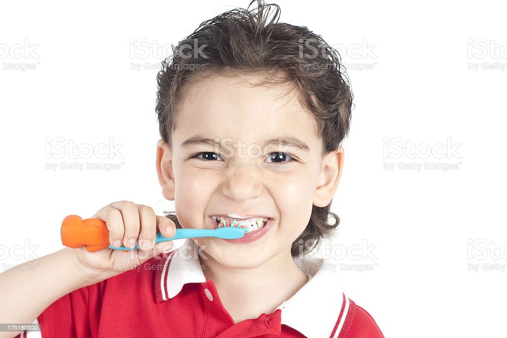 Young child brushing his teeth stock photo