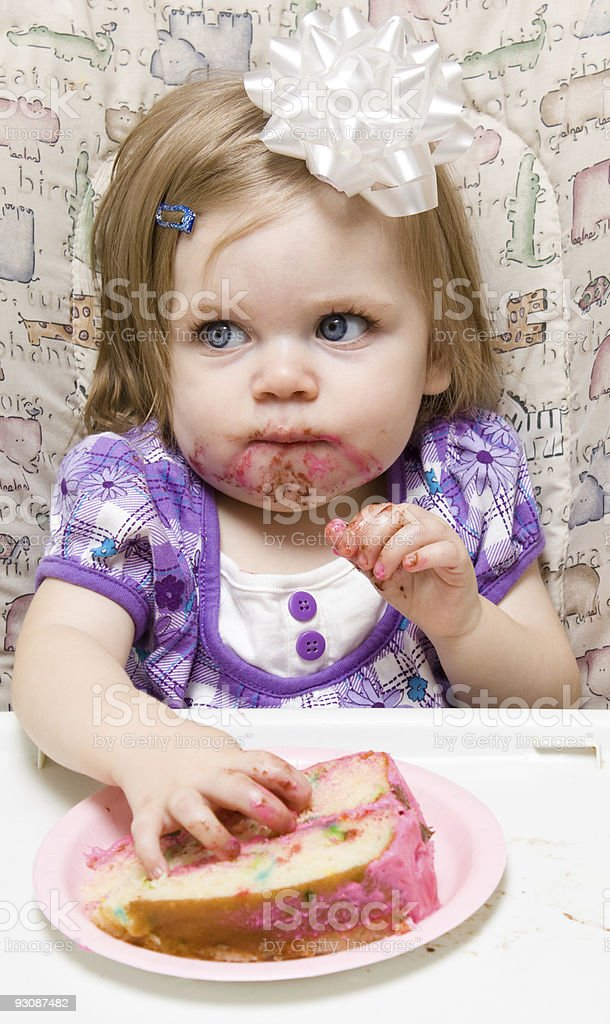 Young child celebrating her first birthday stock photo