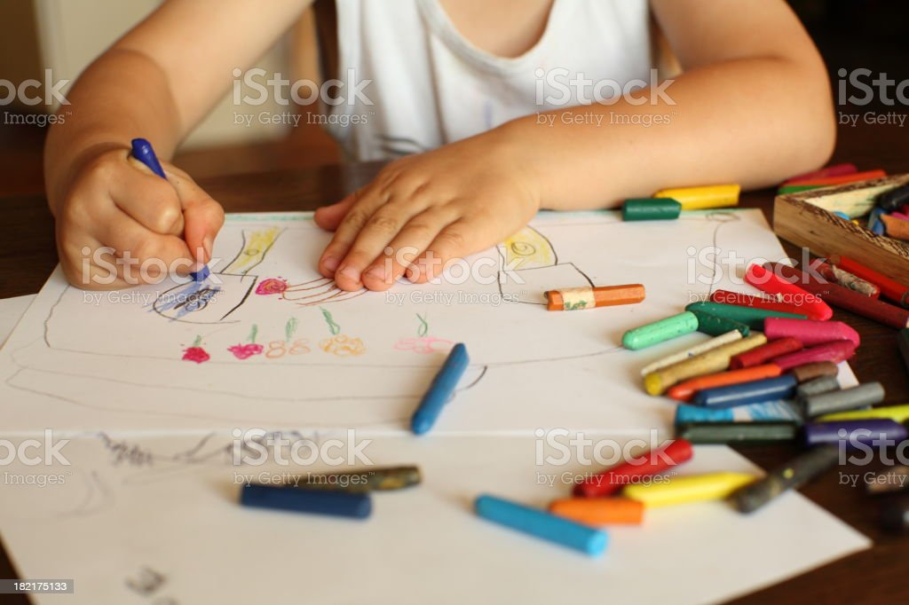 Young child drawing and coloring royalty-free stock photo