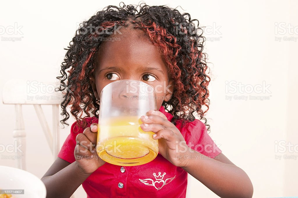 Young child having breakfast stock photo