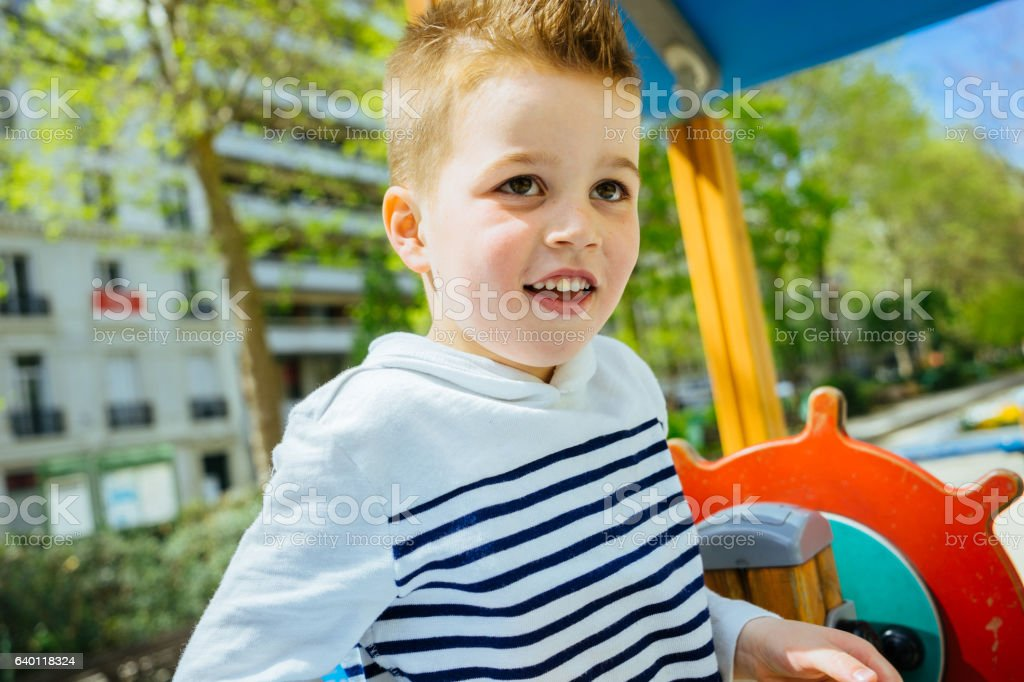 Young child having fun at the playground stock photo