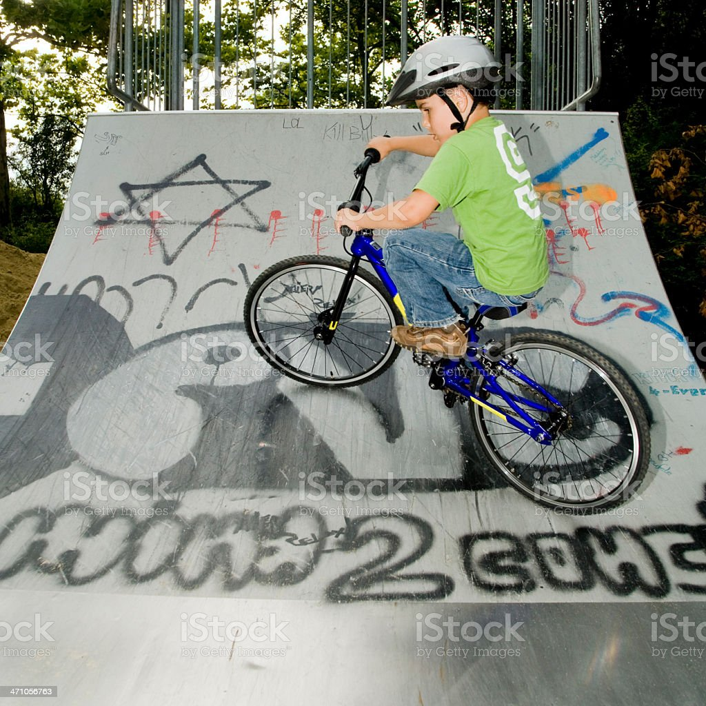 Young Child in BMX Halfpipe royalty-free stock photo
