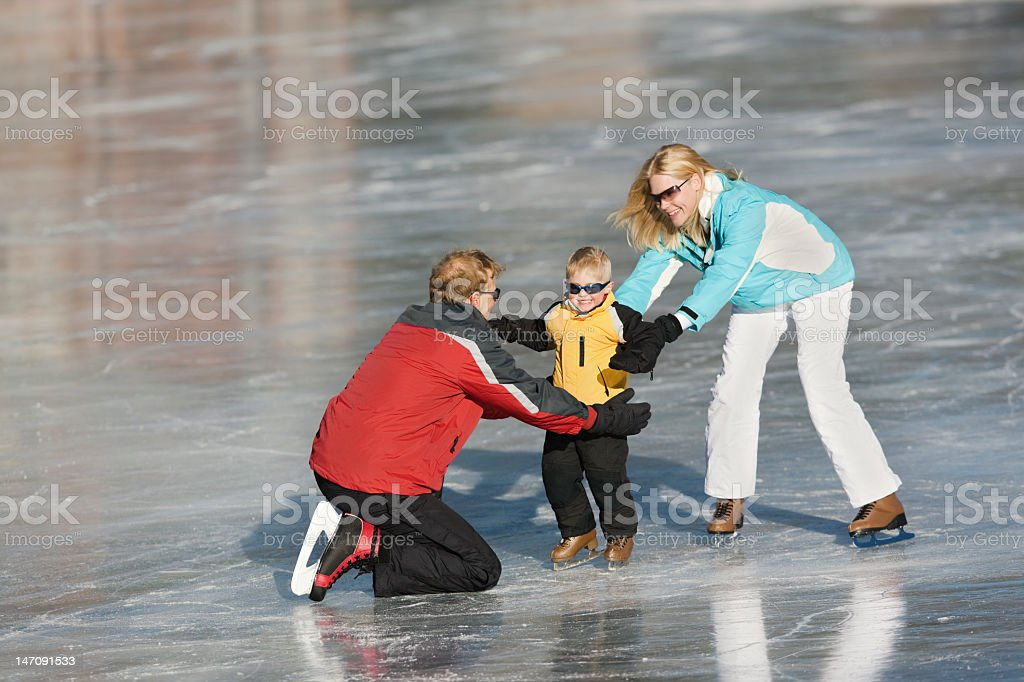 Young Child Learning To Ice Skate royalty-free stock photo