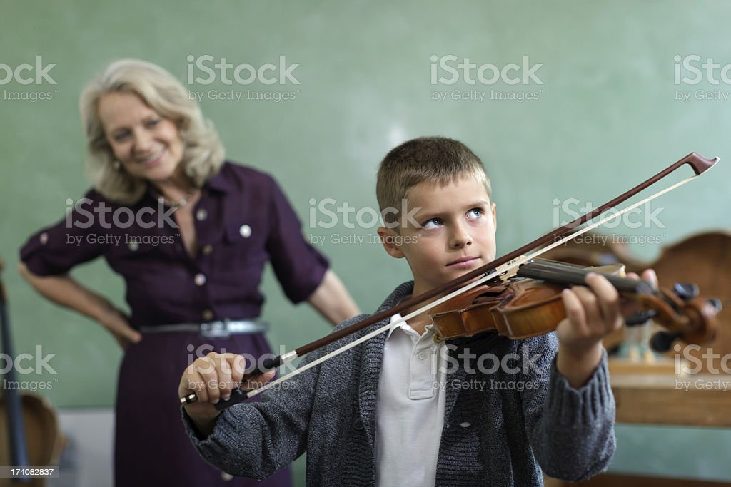 Young Child Learning to Play Violin stock photo