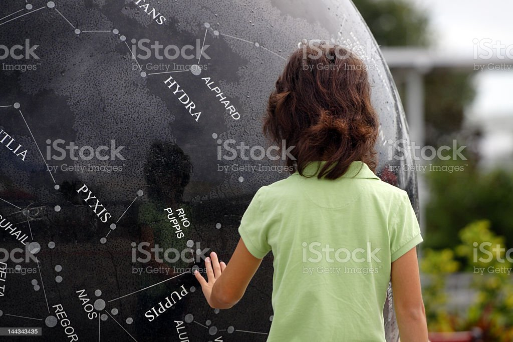 Young child looking at constellations stock photo