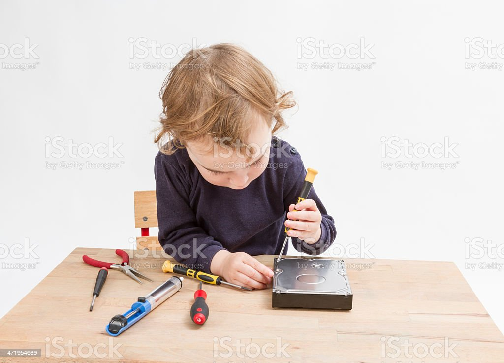 young child opening hard drive stock photo