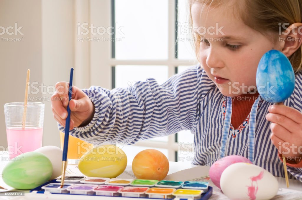 Young Child Painting Easter Eggs royalty-free stock photo