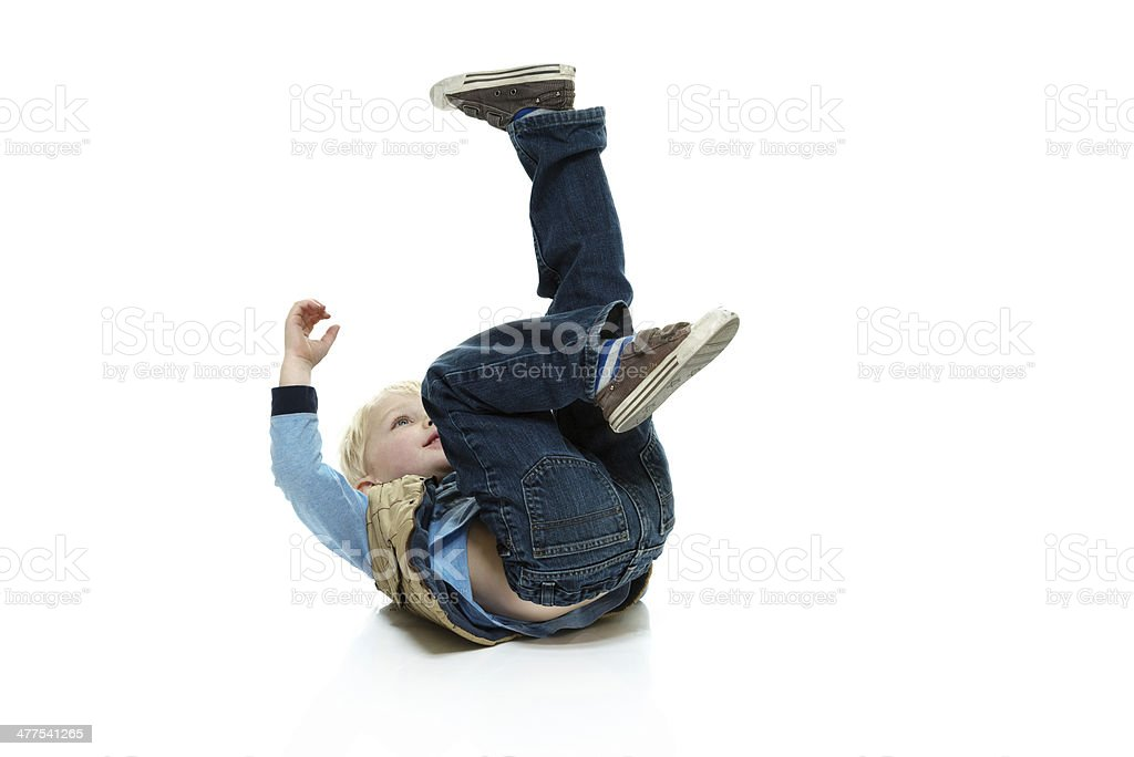 Young child rolling on the floor stock photo