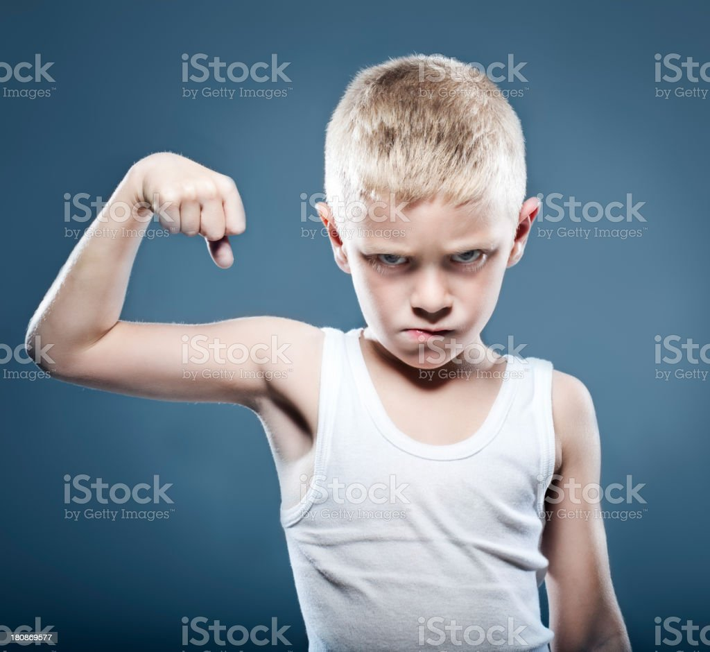 Young child showing his muscles stock photo