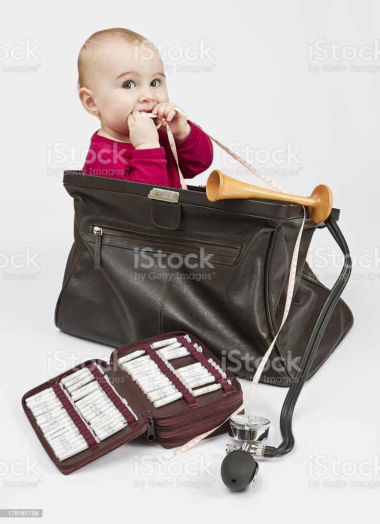 young child sitting in midwifes case royalty-free stock photo