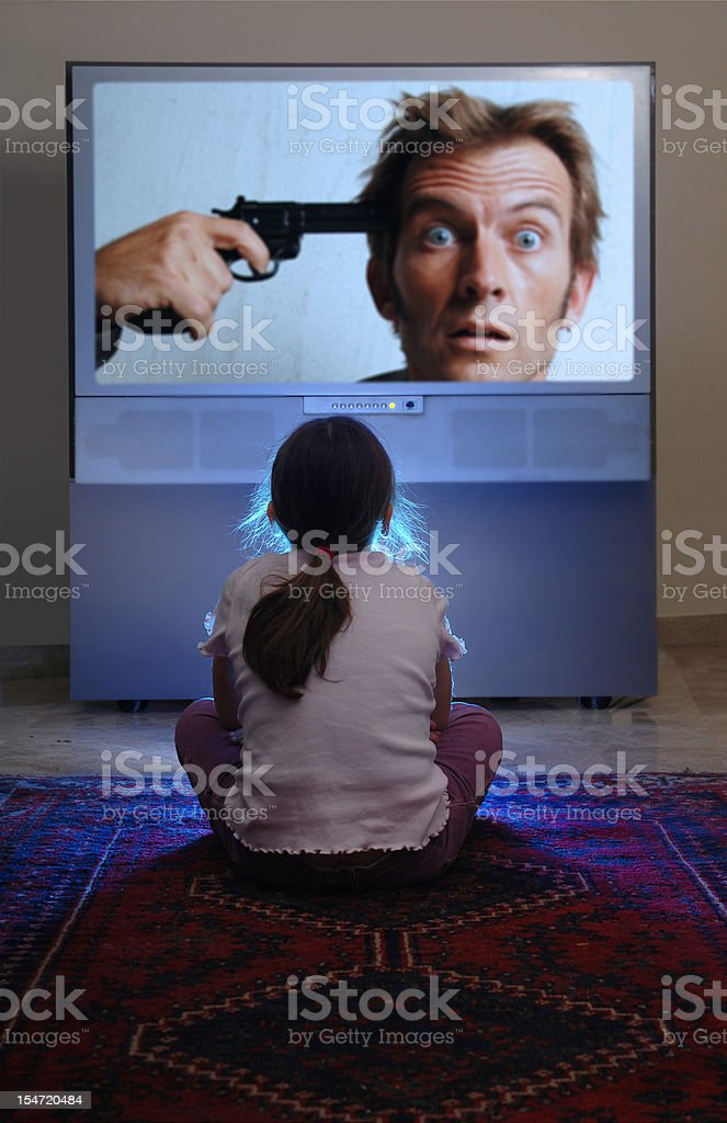 Young Child Watching Violent Television stock photo