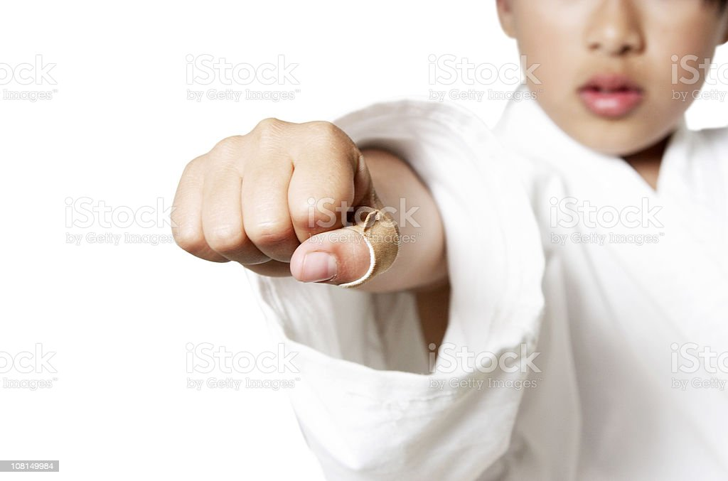 Young Child Wearing Gi and Throwing Punch stock photo