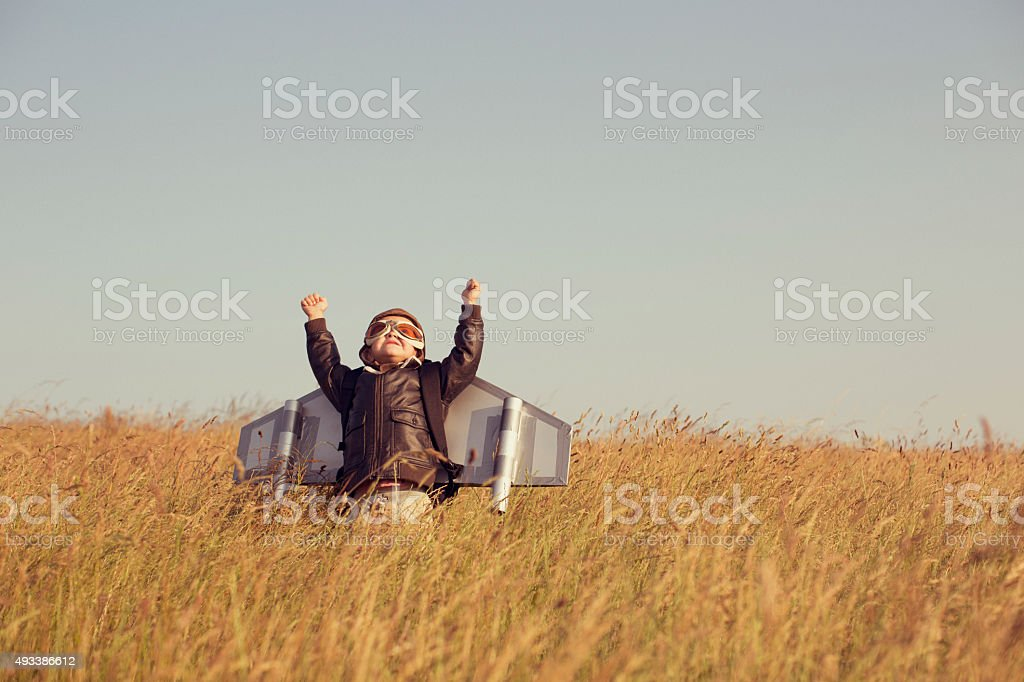 Young Child wearing Jetpack is Taking Off stock photo