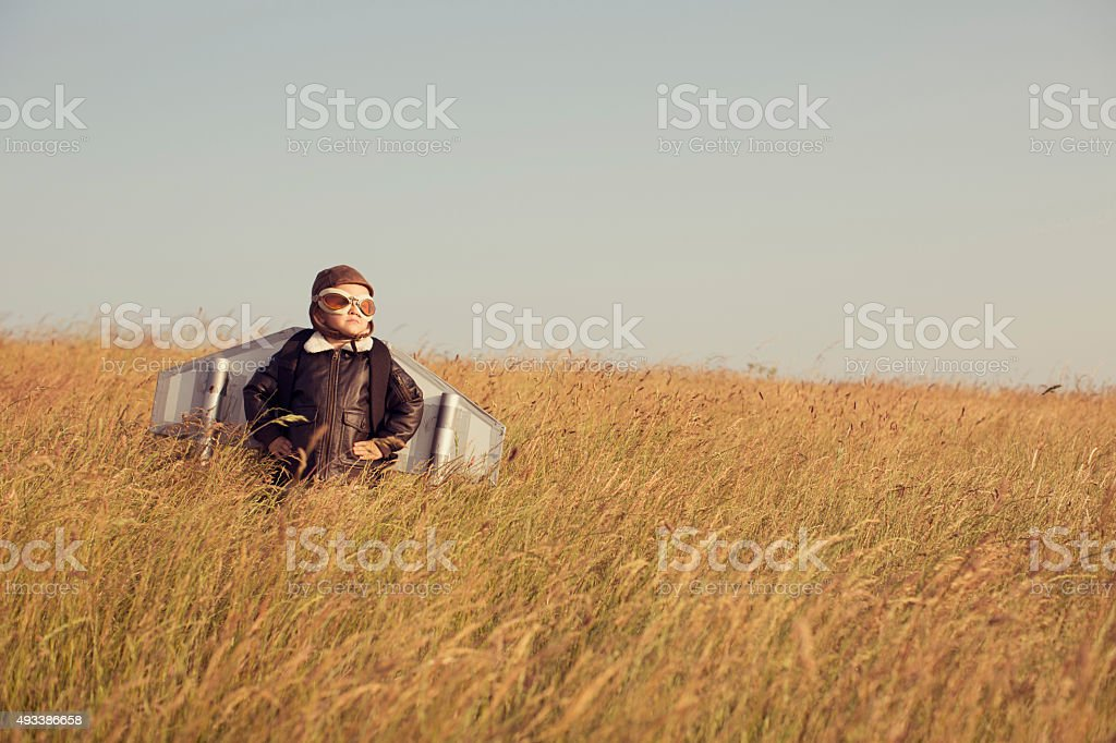 Young Child wearing Pilot Gear and Jetpack stock photo