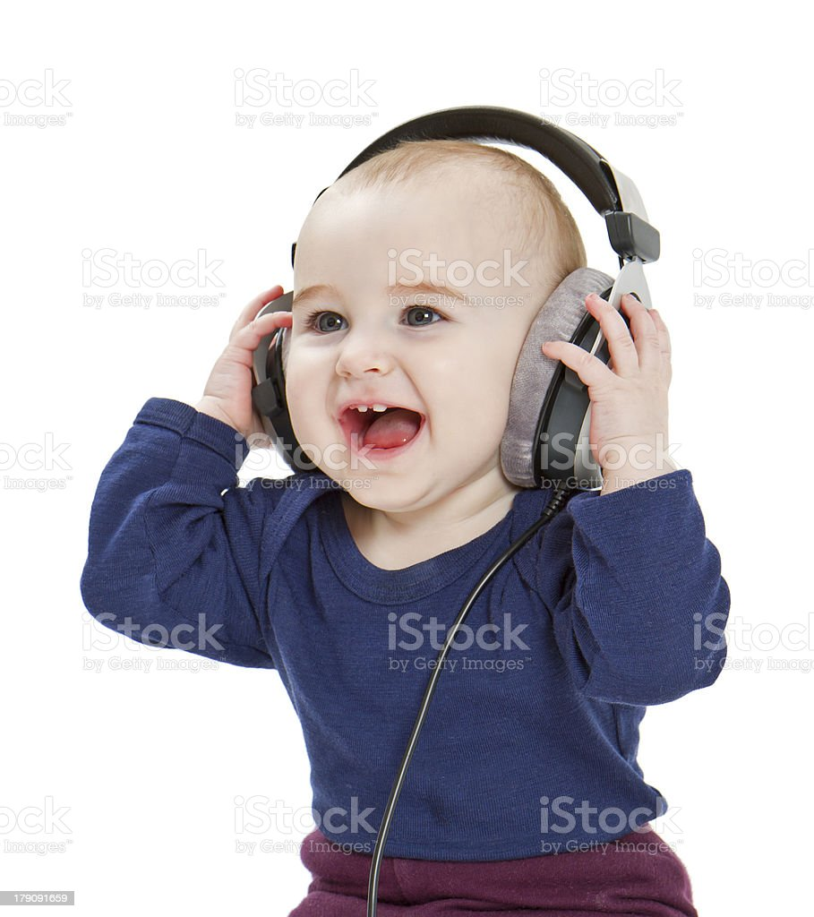 young child with ear-phones listening to music stock photo