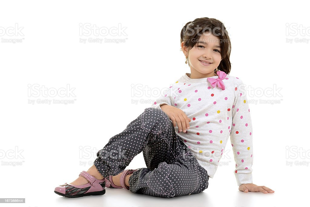 young child with pink bow sitting royalty-free stock photo