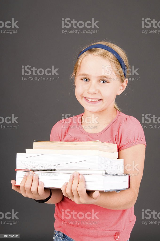 Young child with school books stock photo