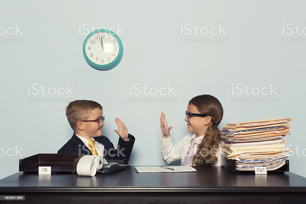 Young Children Business Team Give High Five stock photo