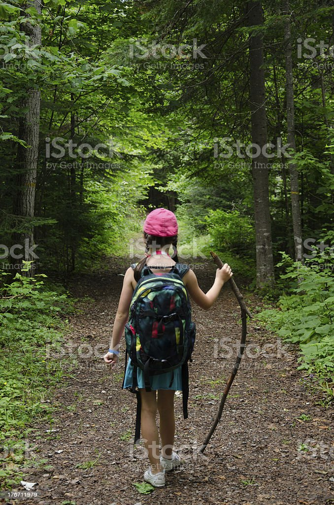 Young children hiking in forest, freedom royalty-free stock photo