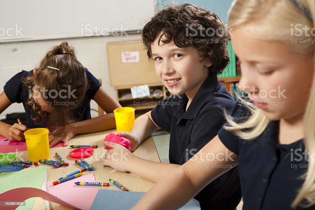 Young children make projects in art class royalty-free stock photo