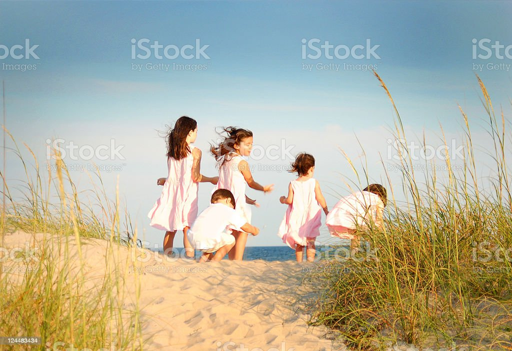 Young Children on a beach sand dune royalty-free stock photo