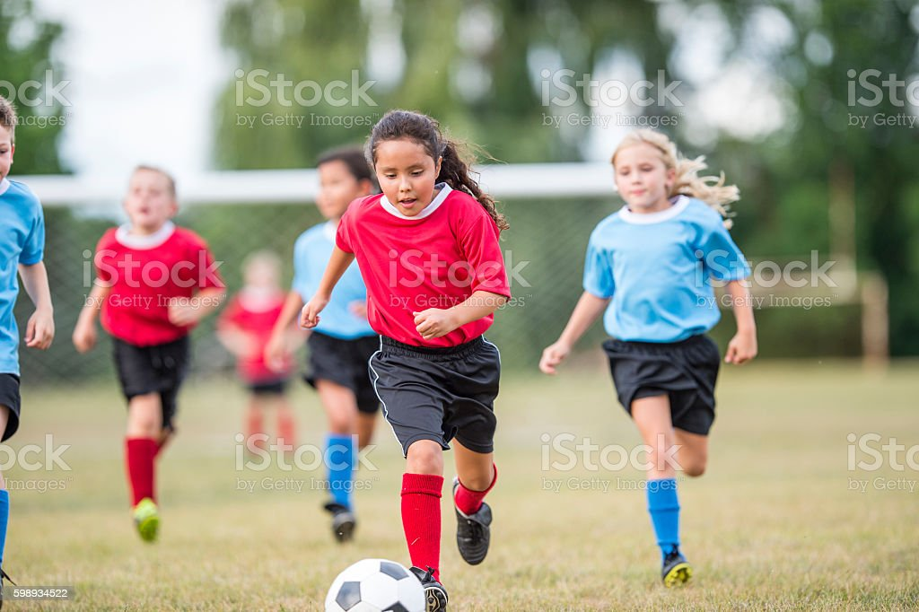Young Children Playing Soccer stock photo