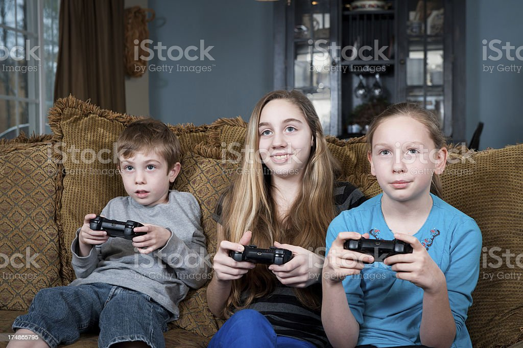 Young children playing video games on television royalty-free stock photo