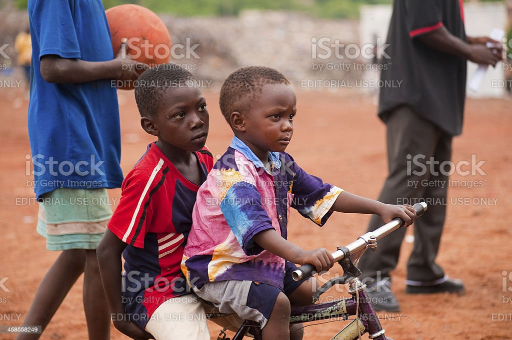 Young children riding a bike stock photo